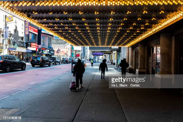 A few people move around the Theatre District on the same day that New York State Governor Andrew Cuomo pleads with New York residents to take the...