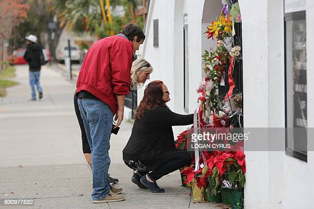 A few people stop to observe the makeshift memorial in front of Mother Emanuel AME Church in downtown Charleston South Carolina on January 4 2017...