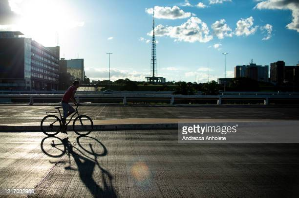 Few people travel through downtown Brasilia, during the coronavirus pandemic on March 31, 2020 in Brasilia, Brazil. According to the Ministry of...
