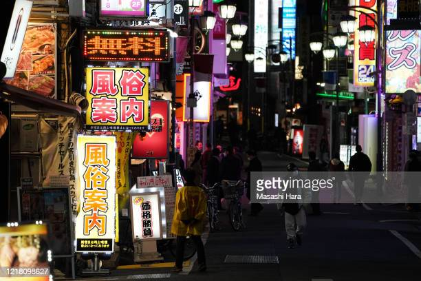 Few people walk at Kabukicho entertainment district in Shinjuku amid the novel coronavirus pandemic on April 10, 2020 in Tokyo, Japan. Japan had 575...