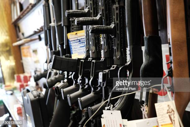 Few rifles remain on the shelf at Caso's Gun-A-Rama store on March 25, 2021 in Jersey City, New Jersey. Caso's Gun-A-Rama has had a significant...