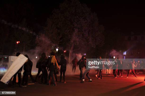 A few rioters are seen throwing objects and fireworks at police forces blocking the access to the square during a demonstration in Place de la...