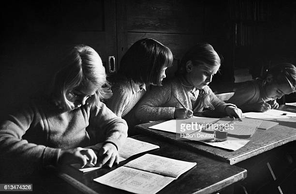 A few students from the Yafflesmead Kindergarten and Junior School study with their school books | Location Kingsley Green Sussex England UK