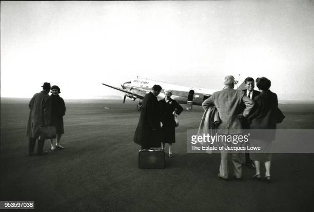 Few supporters turn out to greet American politician Senator John F Kennedy , his wife, Jacqueline Kennedy , and JFK campaign staffer Pierre Salinger...