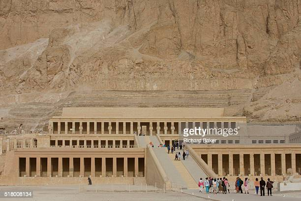 A few tourists approach the ancient Egyptian Temple of Hatshepsut near the Valley of the Kings Luxor Nile Valley Egypt The Mortuary Temple of Queen...