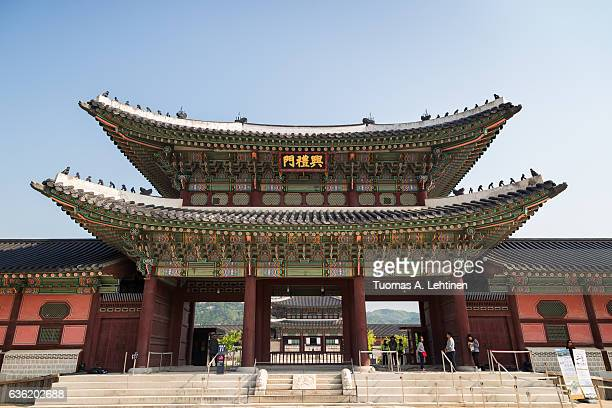 Few tourists at the Heungnyemun Gate at the Gyeongbokgung Palace, the main royal palace of the Joseon dynasty, in Seoul, South Korea, viewed from the front.