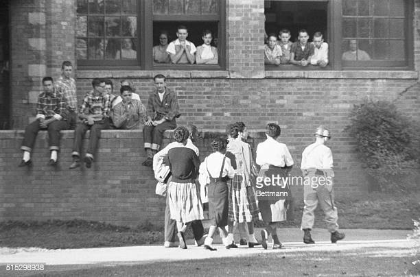 A few weeks after the desegregation of Little Rock's Central High School only six of the nine African American students are escorted into the school...