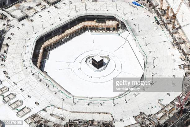 A few workers are seen nearby empty Kaaba after the precautions against the novel coronavirus are taken in Mecca Saudi Arabia on April 07 2020...