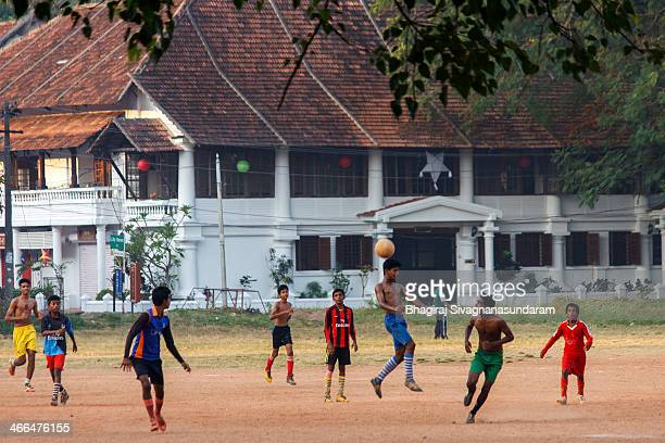 CONTENT] Few youngsters playing football in the Parade ground in Fort KochinKeralaA building raised during colonial period can be seen at the...