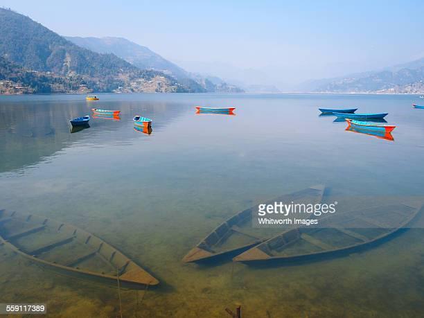 Fewa Lake with sunken boats, Pokhara, Nepal