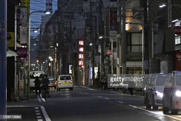 Fewer people than usual are seen in a commercial district in Fukui, central Japan, on April 4 amid the spread of the new coronavirus.