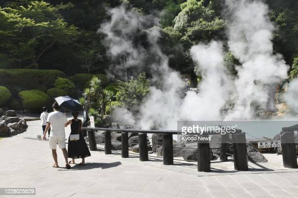 Fewer people than usual take a stroll around Sea Hell, a pond of boiling blue water, in the hot spring resort city of Beppu in Oita Prefecture,...