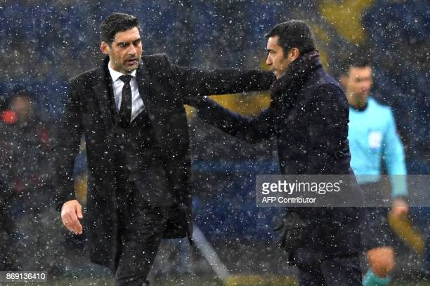 Feyenoord coach Giovanni van Bronckhorst and Shakhar coach Paulo Fonseca shake hands after the UEFA Champions League Group F football match between...
