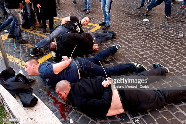 Feyenoord fans arrested after that clash with riot police at Spagna Square on Febraury 19 2015 in Rome Italy Launch of smoke and paper bombs in...