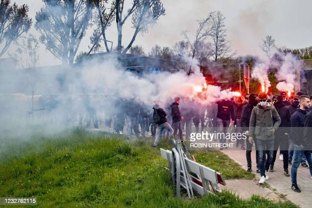 Feyenoord fans hold flares in Rotterdam, on May 8 during gathering at the team's training field despite Covid-19 restrictions ahead of the run-up to...