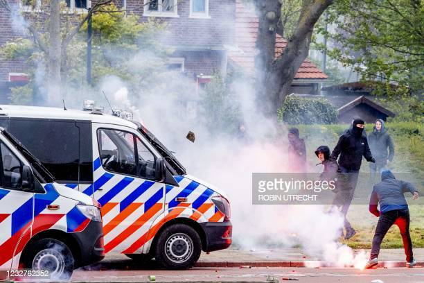 Feyenoord fans throw fireworks and stones at the police in Rotterdam, on May 8 after they came to Feyenoord's training field to cheer the players...
