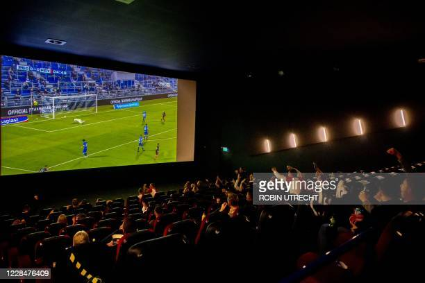 Feyenoord fans watch the Eredivisie ligue match PEC Zwolle against Feyenoord at the Pathe De Kuip cinema in Rotterdam on September 12 as fans...