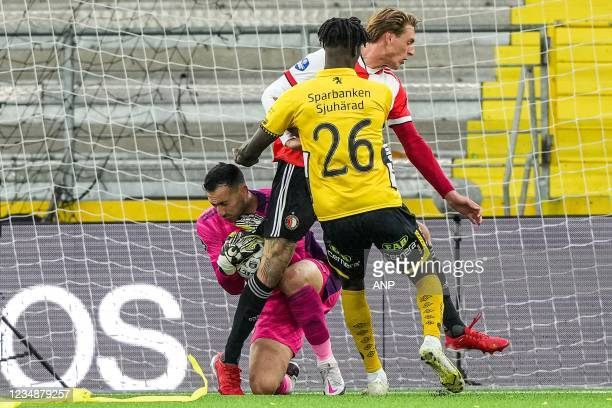 Feyenoord goalkeeper Ofir Marciano, Wouter Burger of Feyenoord, Marokhy Ndione of Elfsborg during the UEFA Conference League play-offs match between...