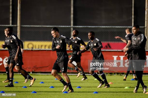 Feyenoord players players attend a training session in Rotterdam on October 16 2017 on the eve of the UEFA Champions League football match between FC...