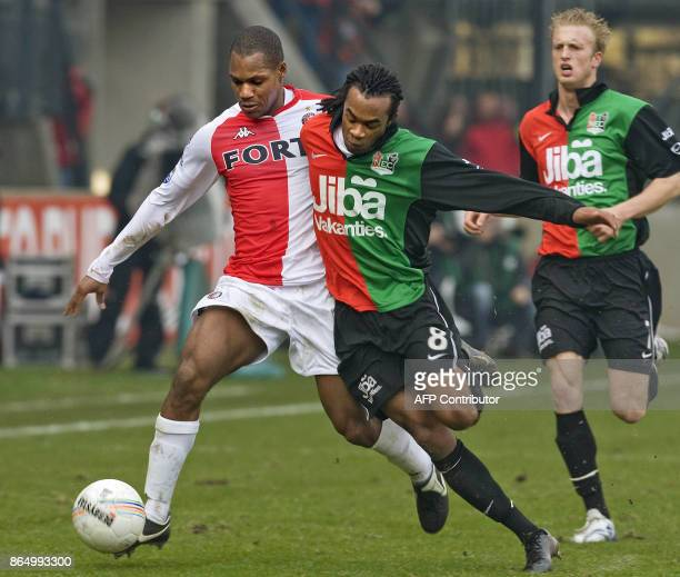 Feyenoord Rotterdam's Andre Bahia vies for the ball with NEC Nijmegen's Lorenzo Davids during their national championship football match in Nijmegen...