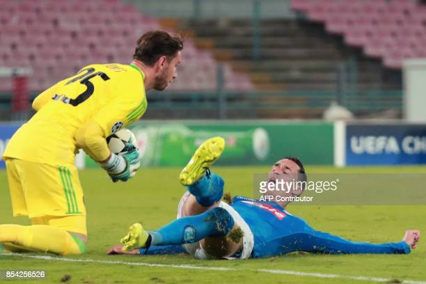 Feyenoord's Australian goalkeeper Brad Jones saves the ball in front of Napoli's midfielder from Spain Jose Maria Callejon during the UEFA Champion's...