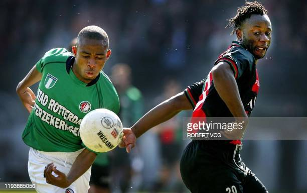 Feyenoord's Bonaventure Kalou vies with NEC's Zico Tumba during the Dutch soccer league in Amsterdam the Netherlands Feyenoord won 21 AFP PHOTO...