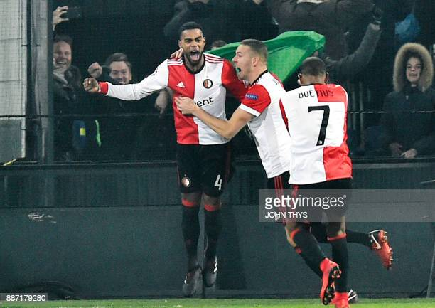 Feyenoord's Dutch defender Jeremiah St Juste celebrates with teammates after scoring a goal during the UEFA Champions League Group F football match...