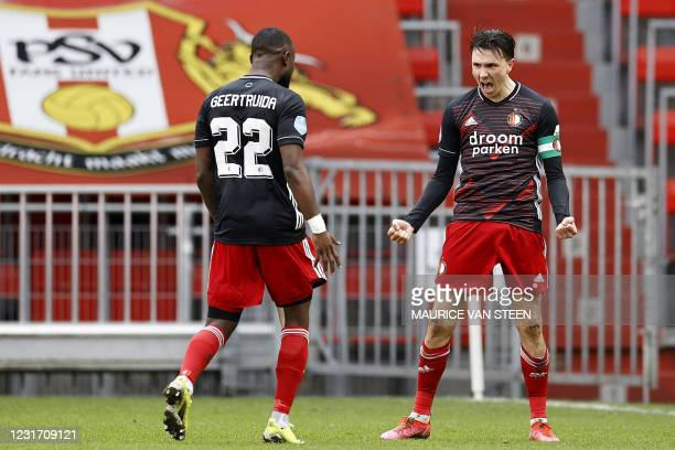 Feyenoord's Dutch defender Lutsharel Geertruida and team mate Dutch forward Steven Berghuis celebrate their 0-1 during the Dutch Eredivisie match...