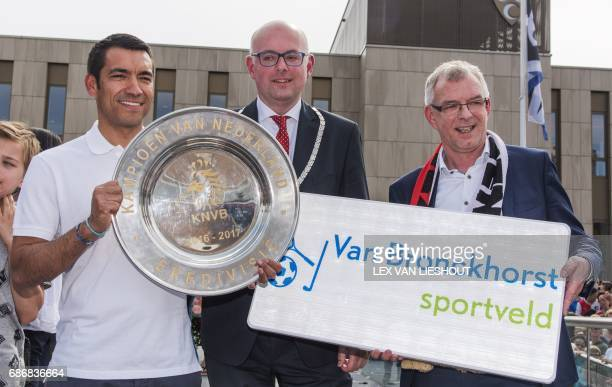 Feyenoord's Dutch head coach Giovanni van Bronckhorst poses with the Dutch Eredivisie winner's plate during the honouring of the coach for winning...