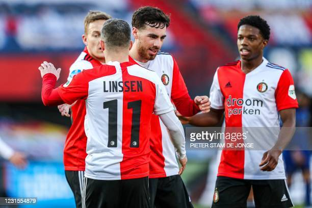 Feyenoord's Jens Toornstra, Orkun Kokcu, Bryan Linssen, and Tyrell Malacia celebrate their team's third goal during the Dutch Eredivisie football...