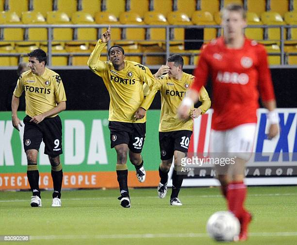Feyenoords Leroy Fer celebrates with his teammates Roy Makaay and Luigi Bruins after scoring in their first round second leg UEFA Cup soccer match...