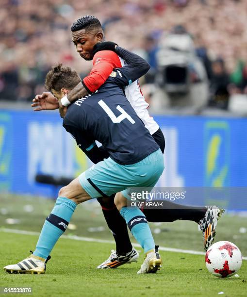 Feyenoord's midfielder Eljero Elia and PSV's Colombian defender Santiago Arias hold each other during the Dutch Eredivisie fottball match Feyenoord...