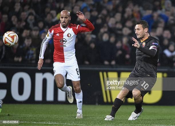 Feyenoord's midfielder Karim El Ahmadi vies with AS Roma's forward Francesco Totti during the UEFA Europa League round of 32 secondleg football match...