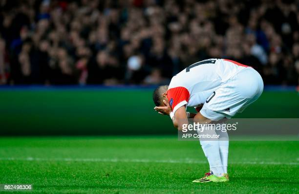 Feyenoord's midfielder Tonny Trindade de Vilhena reacts after scoring a goal during the UEFA European Champions League Group F football match between...