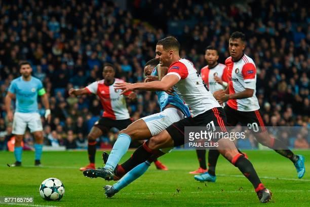 TOPSHOT Feyenoord's Moroccan midfielder Sofyan Amrabat tackles Manchester City's English midfielder Raheem Sterling during the UEFA Champions League...