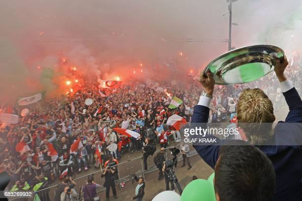 Feyenoord's player and supporters cheer as the team presents the trophy after winning The Netherland's Eredivisie football league on May 15, 2017 in...