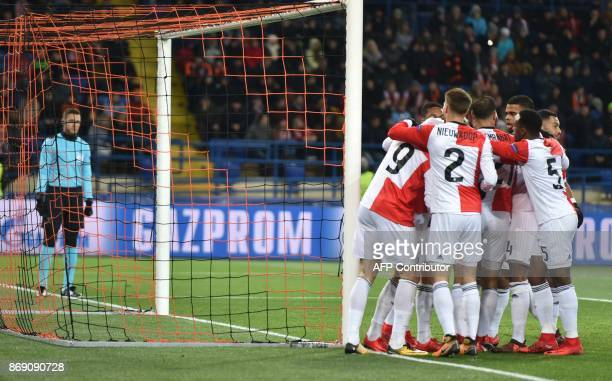 Feyenoord's players celebrate after scoring a goal during the UEFA Champions League Group F football match between FC Shakhtar Donetsk and Feyenoord...