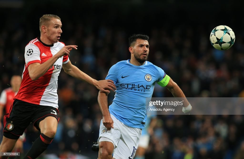Feyenoord's Sven van Beek (L) in action against Manchester CityÕs Sergio Aguero during the Champions League group stage soccer match between Manchester City FC and Feyenoord Rotterdam at the Etihad stadium in Manchester, United Kingdom on November 21, 2017.