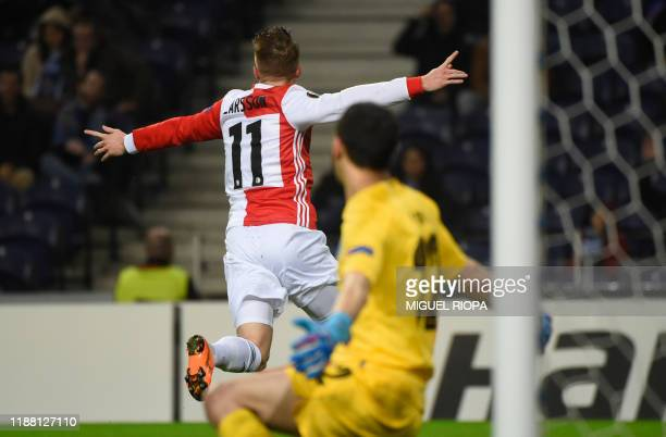 Feyenoord's Swedish forward Sam Larsson celebrates after scoring a goal during the UEFA Europa League Group G football match between FC Porto and...
