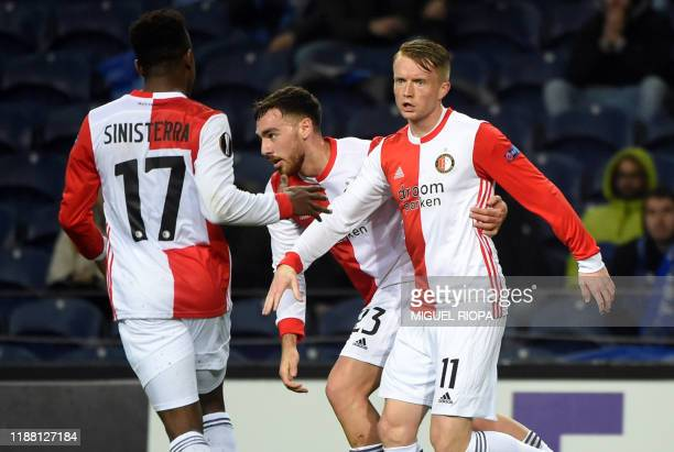 Feyenoord's Swedish forward Sam Larsson celebrates his goal with teammates during the UEFA Europa League Group G football match between FC Porto and...