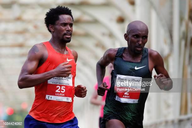 Feyisa Lilesa of Ethiopia and Abdi Abdirahman of the United States compete during the 2018 Rock 'n' Roll Philadelphia Half Marathon on September 16...