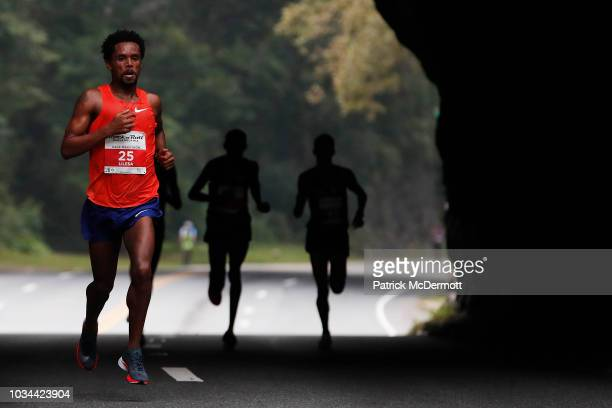 Feyisa Lilesa of Ethiopia competes during the 2018 Rock 'n' Roll Philadelphia Half Marathon on September 16 2018 in Philadelphia Pennsylvania