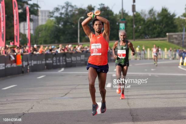 Feyisa Lilesa runs in the Rock 'n' Roll Philadelphia Half Marathon on September 16 2018 in Philadelphia Pennsylvania