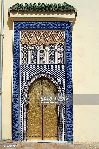 fez royal palace side door. - moroccan culture stock photos and pictures