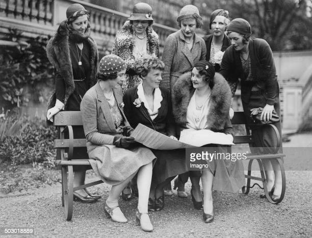 fFemale Flight pilots Mildred Mary Petre and Amelia Earhart and Mrs Claever Standing Lady Bailey Mrs Shelmardine and Peggy Salaman an Mrs Spicer and...