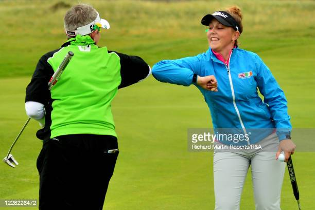 Ffion Tynan of Wales elbow bumps with Laura Webb of Ireland after where victory on the 17th green during Round 2 of Matchplay on Day Three of The...