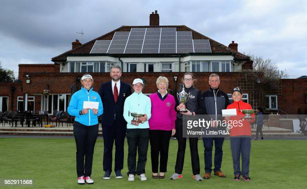 Ffion Tynan Paul Hamlin Beth CoulterGillie Allison Hannah Darling Mark Mendell and Rosie Bee Kim pose with their respective trophies after the final...