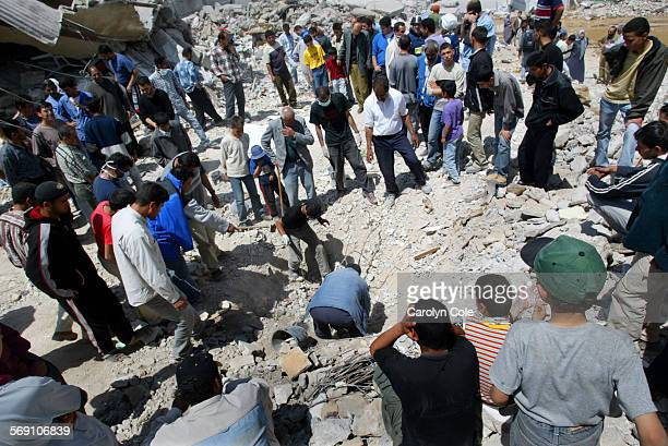 FG0418rubble4cc In Jenin refugee camp residents gather to dig for their dead family members One man Mohammed Masoud Abu Siba died days after being...