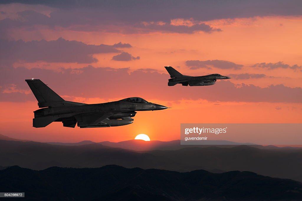 Fıghter Jet in flight at sunset : Stock Photo