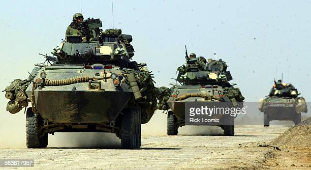 FGwarLAV3/29/2003 RL––Iraq––Light armored vehicles are on the prowl as they patrol a road in southern Iraq These LAV units have been engaged in a...